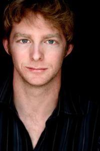 Brian Mackey in the role of John