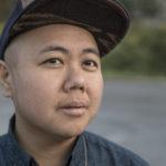 Kit Yan wearing a hat